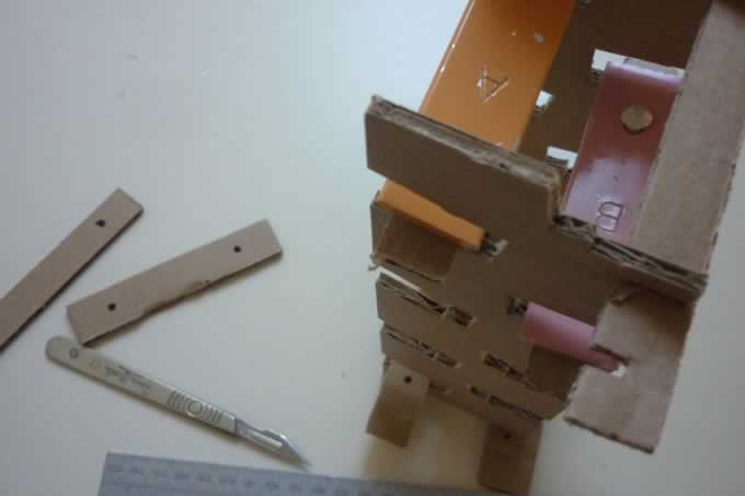 Eames Musical Tower Cardboard Prototype with test bars and scalpel