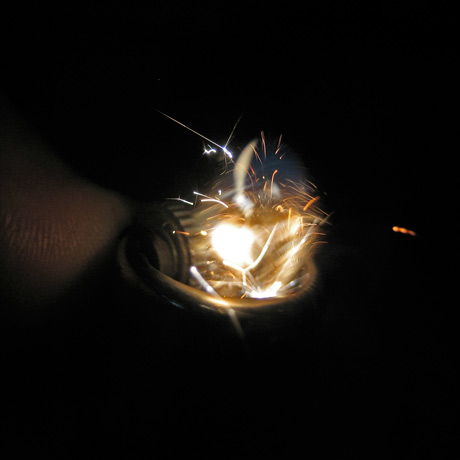 1/10000 sec shutter speed exposure of a lighter being lit, with the gas frozen in time as it begins to ignite