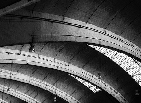 Black and white image of Stockwell bus garage roof interior featuring a large unsupported concrete span.