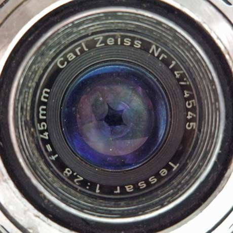 Close up photo of a Zeiss Contaflex lens showing shutter blades