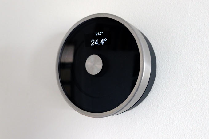 DIY Nest-style Thermostat with brushed steel circular housing showing simple OLED display